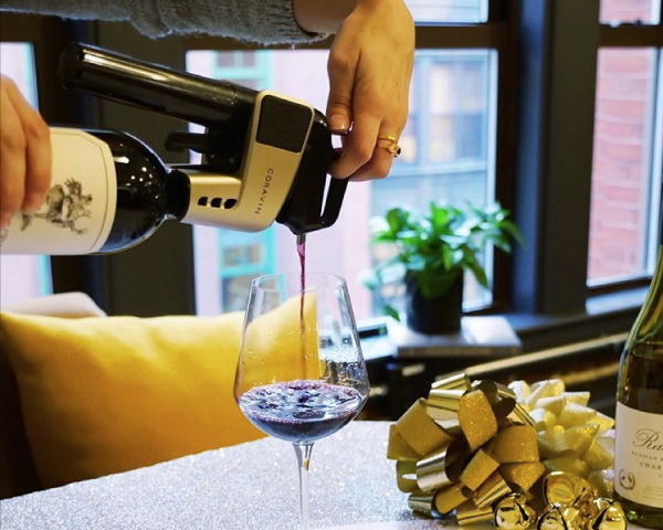Wine being poured using a Coravin for social media content production