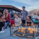people sitting around an outdoor fire pit at CBC Aspen