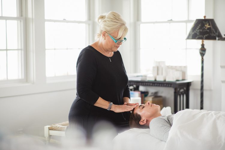 Aesthetician giving media a facial using Biossance products