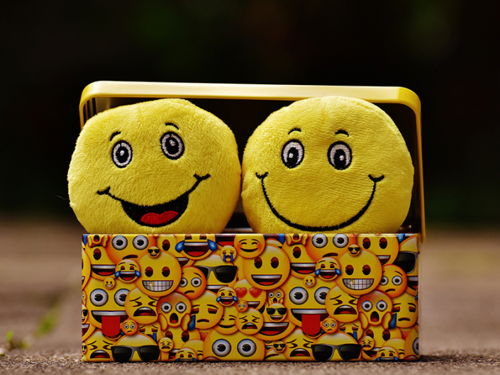 Emoji plushies in emoji box
