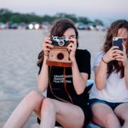 Two female Gen Z teenagers take photos