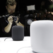 Multiple camera men photographing Google speakers