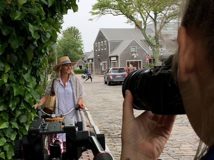 Video crew shooting a female influencer in Nantucket with CBC Sidebar