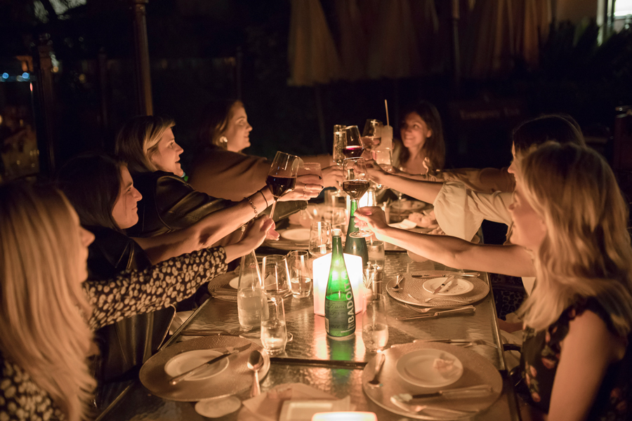 Influencers and editors toasting wine