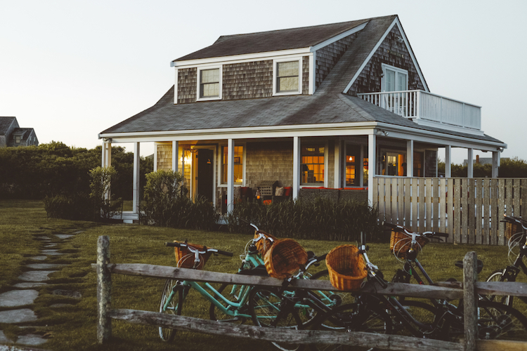 Cottage in Nantucket at dusk with bikes
