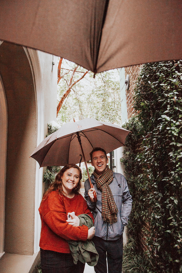 Influencers and press outside under an umbrella at the Charleston Experience