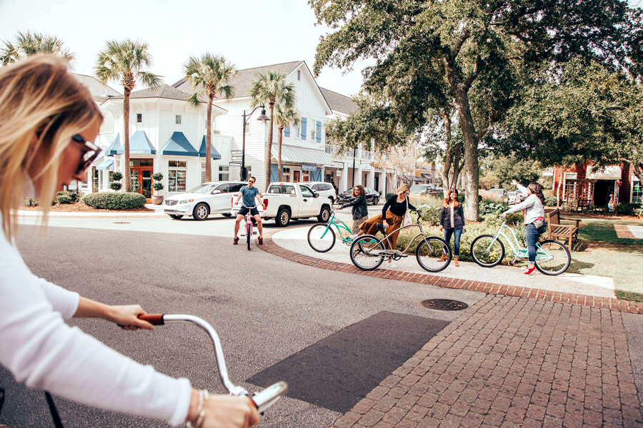 Influencers and press riding bikes in downtown Charleston