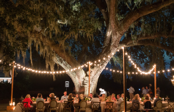 Influencers and press eating dinner outdoors at Charleston experience
