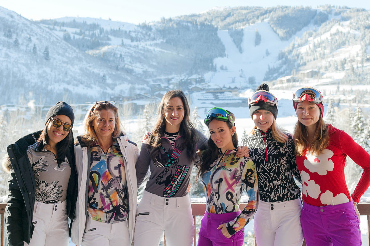 women wearing ski outfits in front of mountain at CBC Deer Valley
