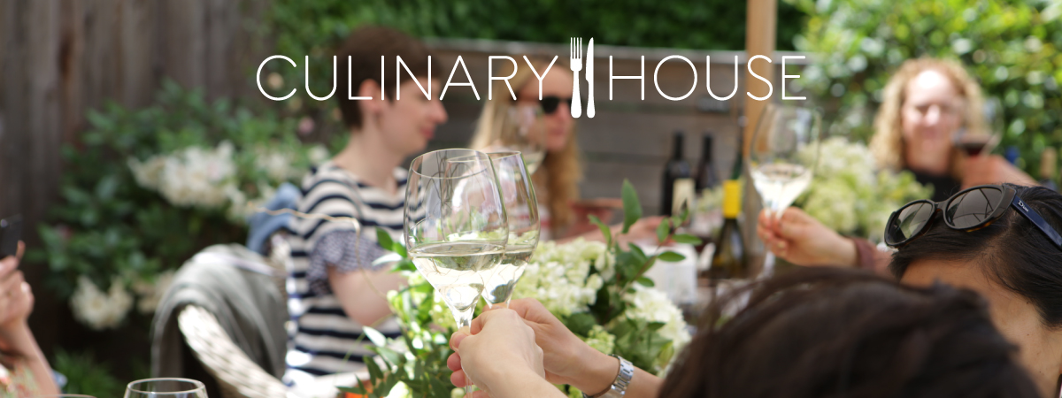 Influencers cheering wine glasses at culinary house
