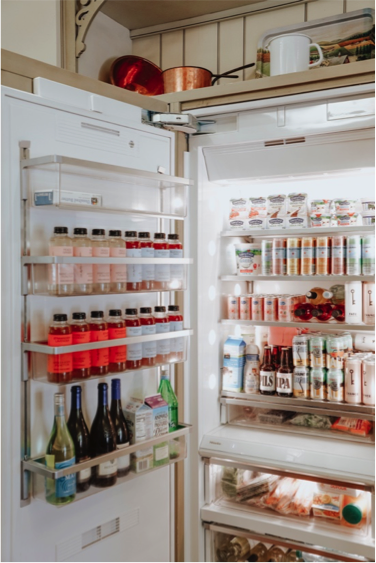 Fridge stocked with beverages at CBC Culinary House