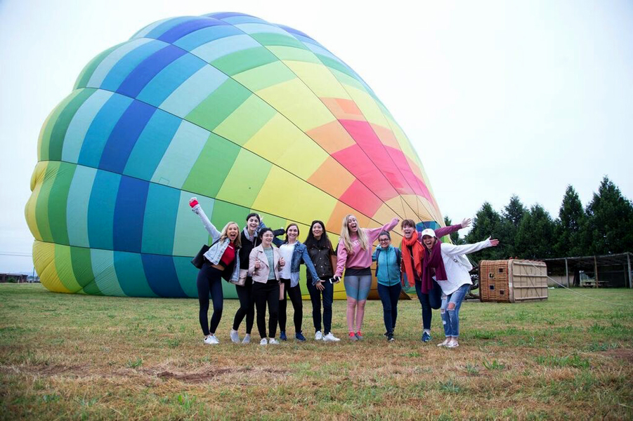 Influencers and editors standing in front of a hot air balloon at Culinary House