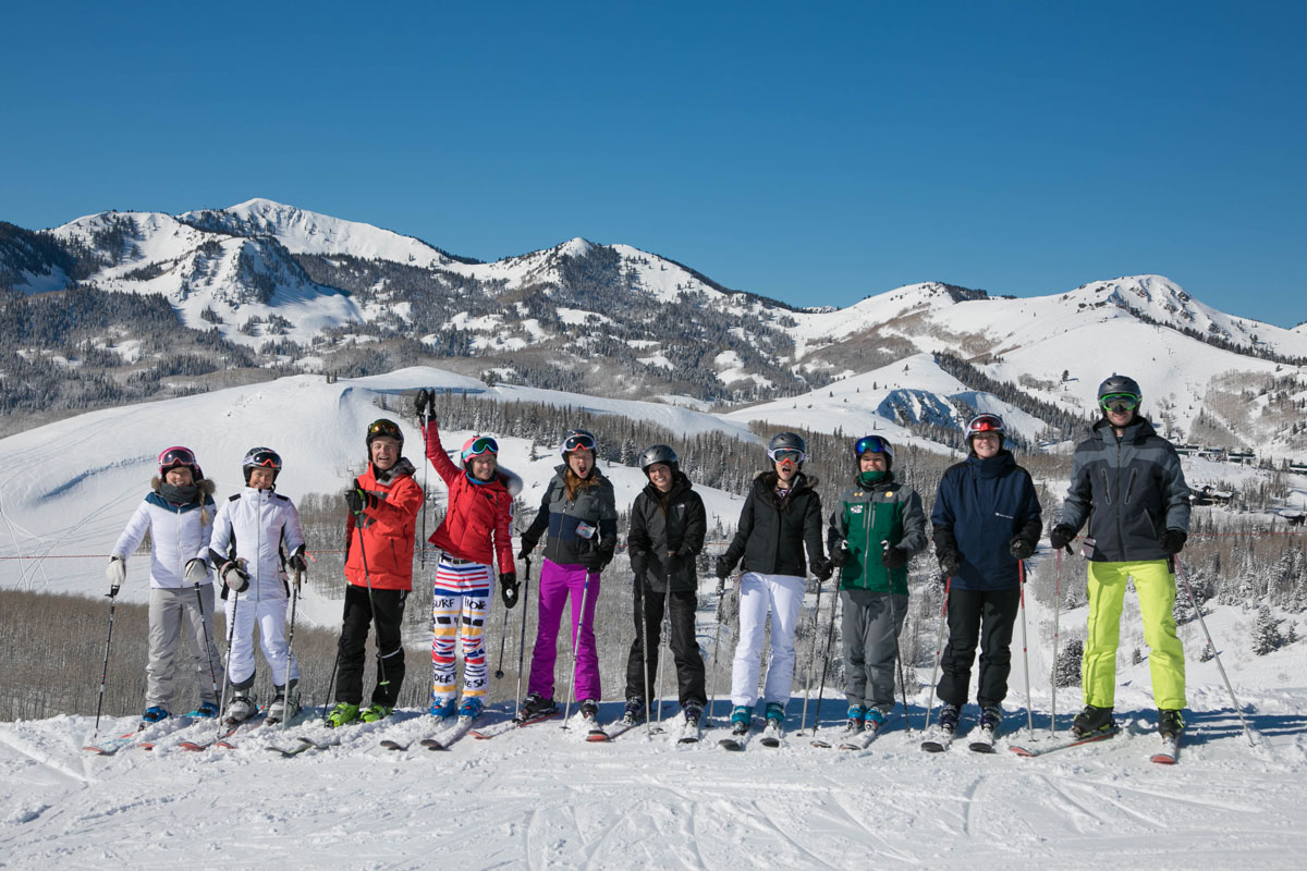 skiers smiling with mountain in background at CBC Deer Valley