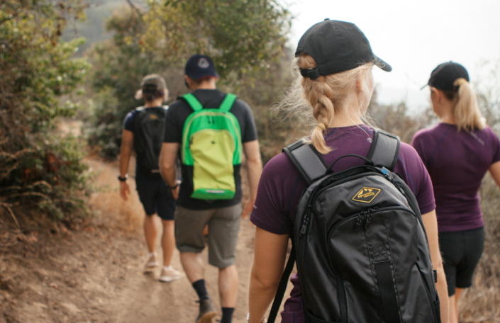 Influencers and press hiking a trail at the Parenting Experience