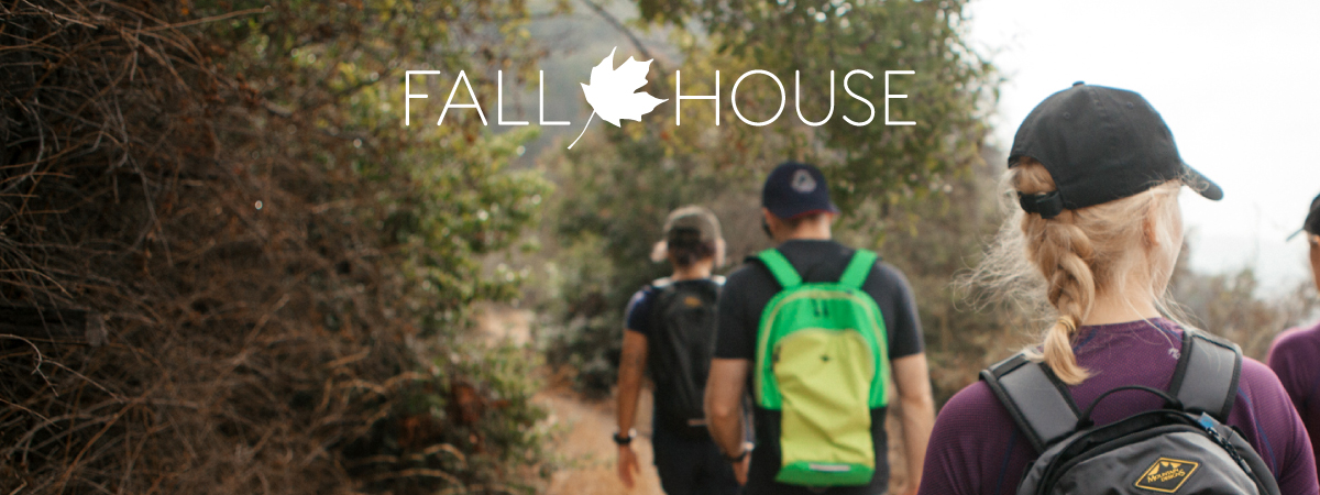 Fall house logo with people hiking as background
