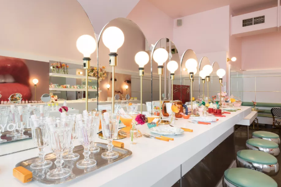 An experiential Glossier pop-up stpre partnership with Rhea's Cafe in San Francisco