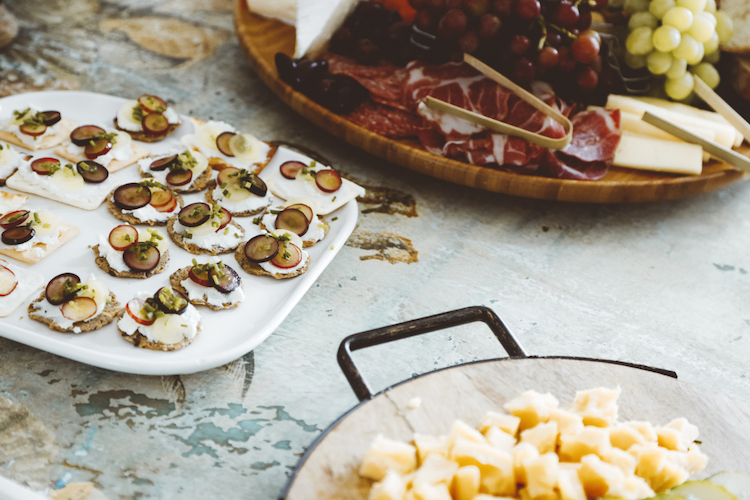Hors d'oeuvres spread including sliced grapes on crackers