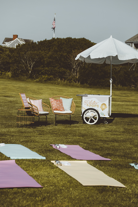 Halo Top ice cream cart with umbrella next to lounge chairs and yoga mats