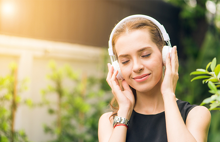 Woman listening to music from experiential program for Headspace