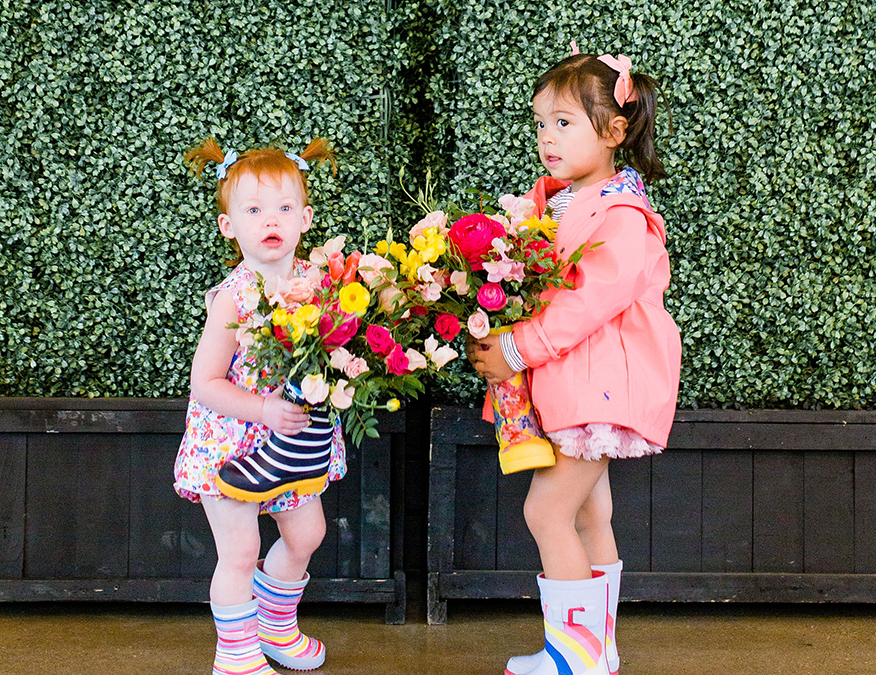 Two little girls holding flowers