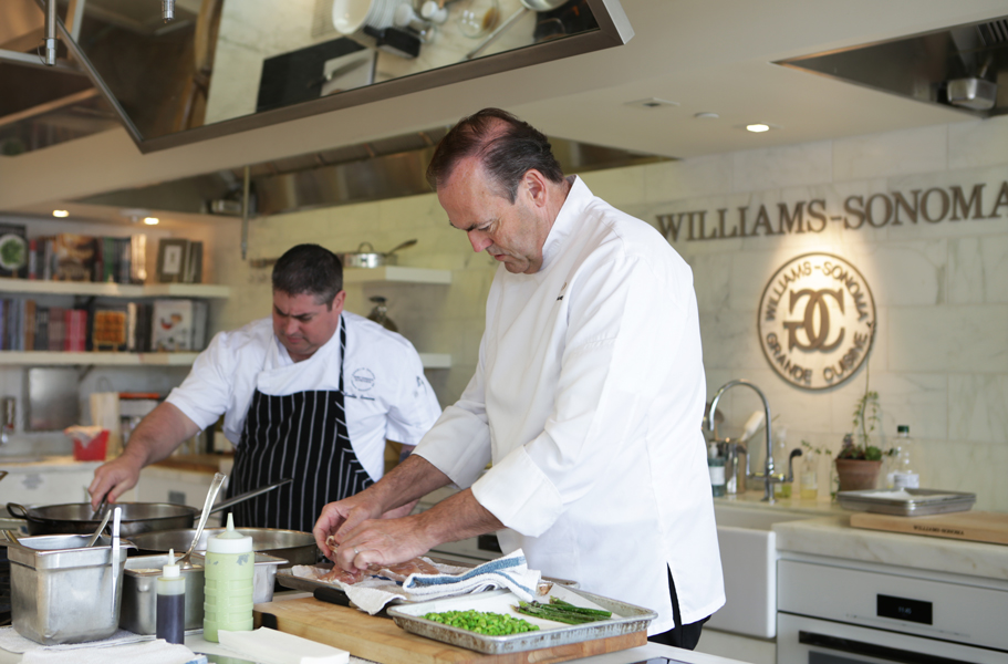 Chefs cooking for influencers and editors at the Culinary House