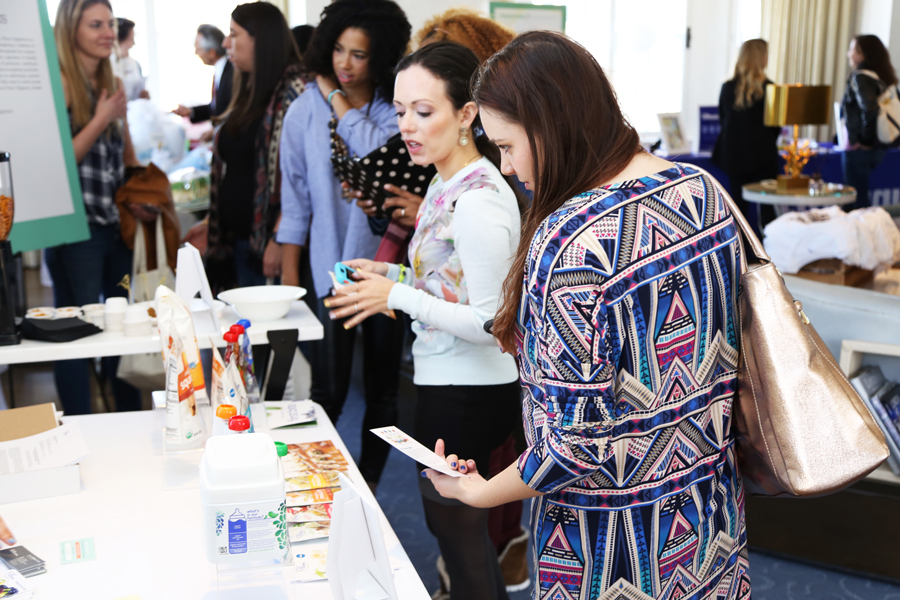 Influencers and press interacting with display at Parenting experience
