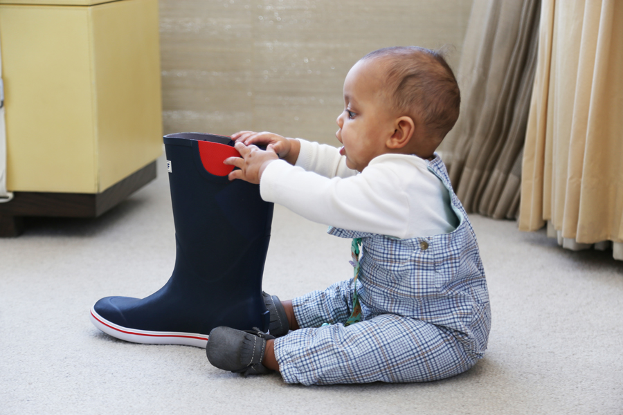 baby playing with boot at Parenting experience