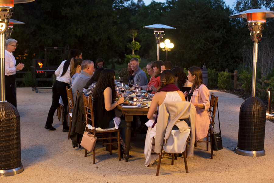 influencers and editors eating dinner outdoors
