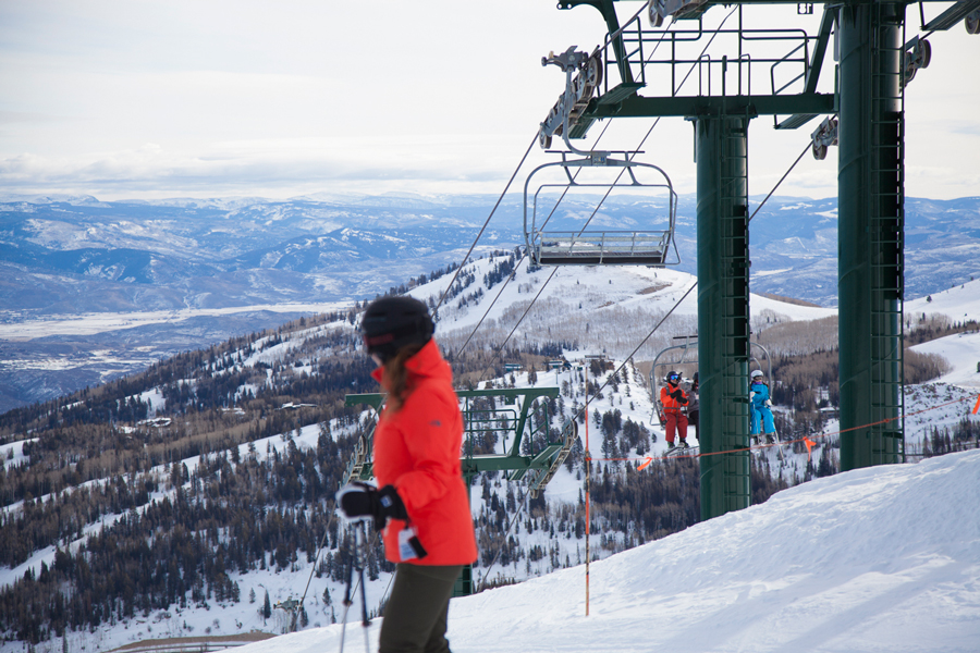 Scenic view of influencer skiing down mountain at Deer Valley Experience