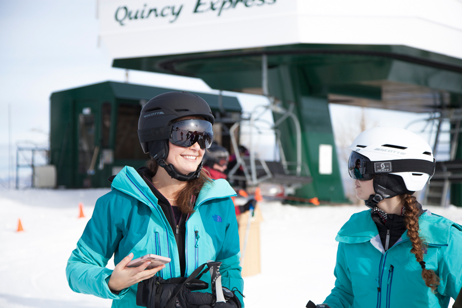 Influencers and editors skiing at the top of Deer Valley mountain