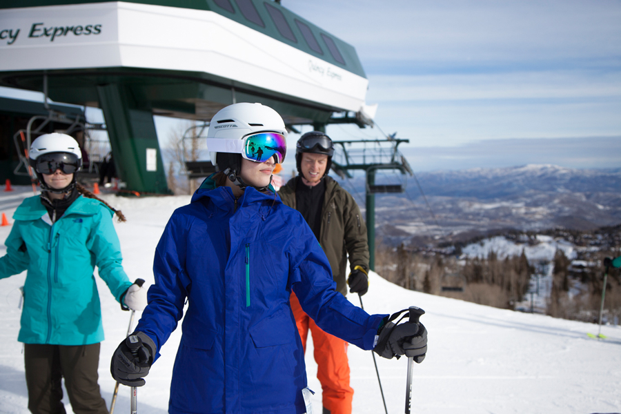 influencers and editors skiing at the top of a snowy mountain
