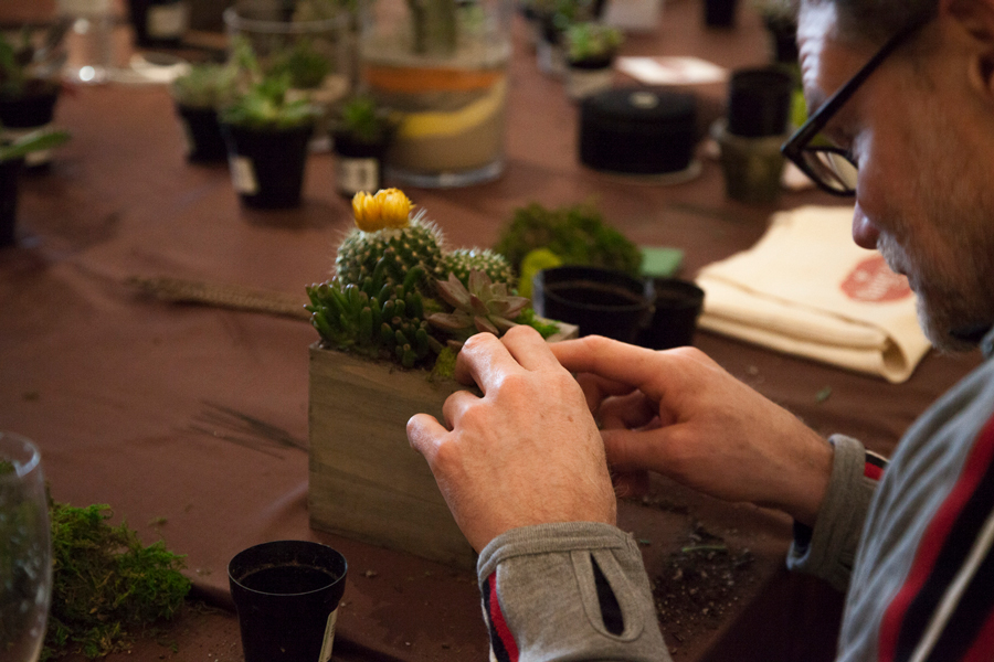 Man building a cactus box at Deer Valley Experience