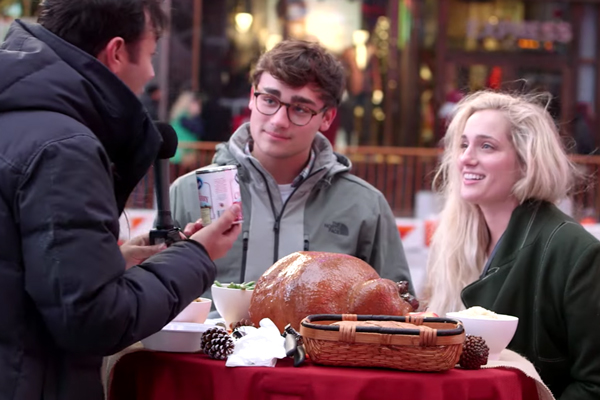 Two tourists being interviewed about Ocean Spray Cranberry Sauce for Thanksgiving in Times Square