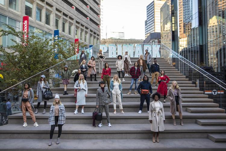 Primark models posed on Downtown Crossing stairs