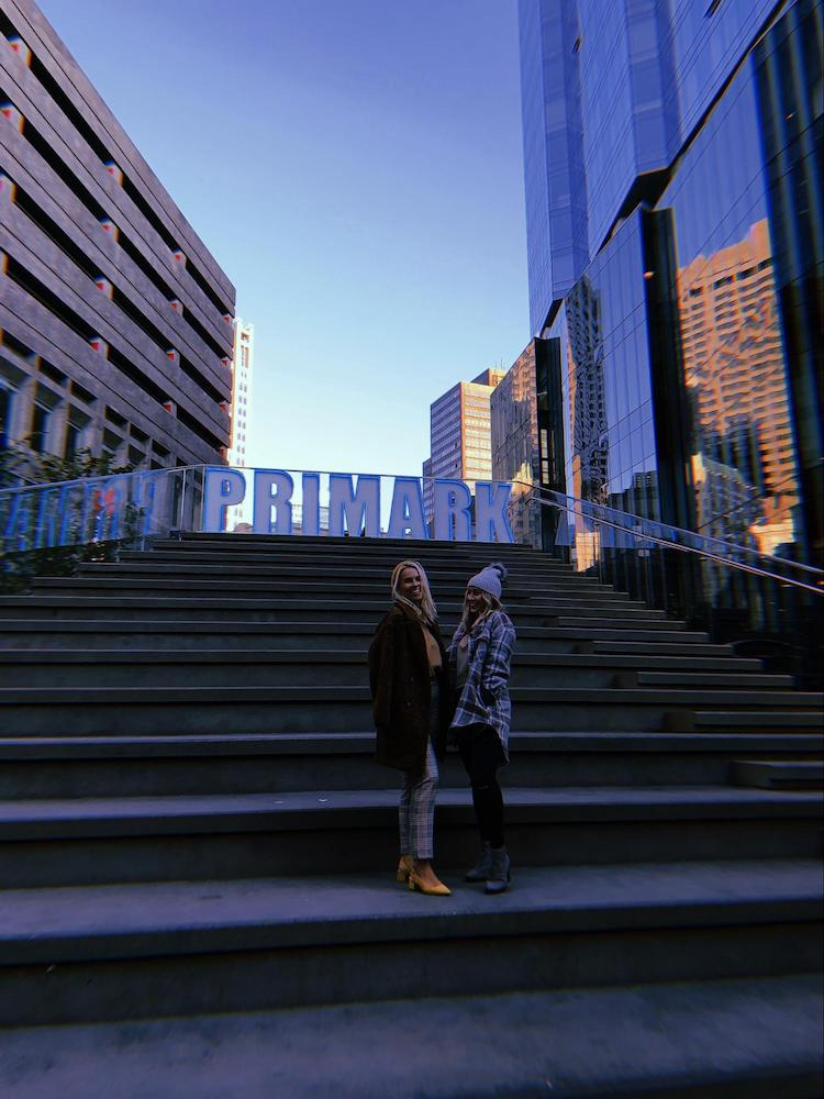 Cercone Brown interns stand in front of Primark sign in Downtown Crossing after fashion show