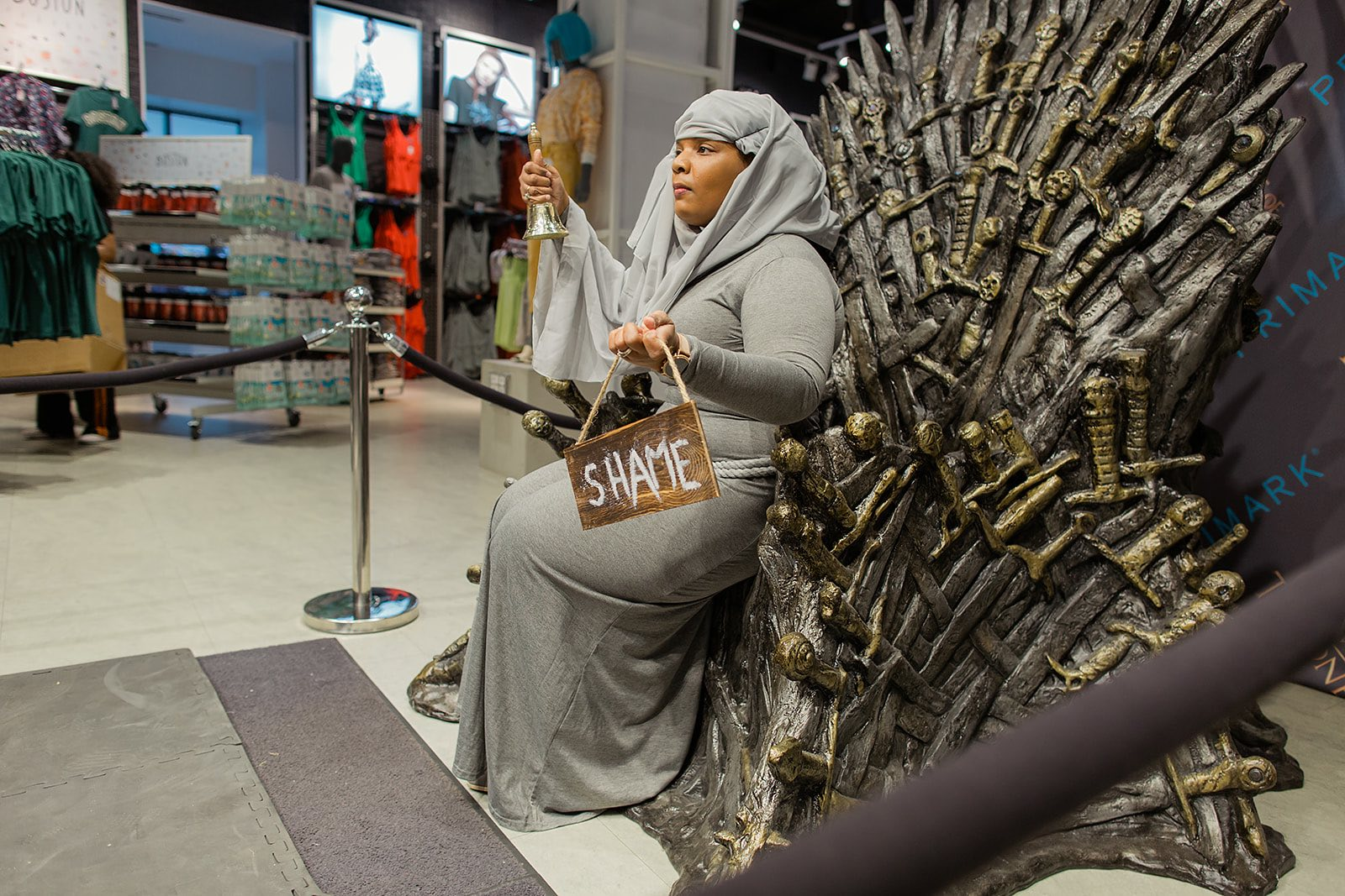 Fans sit on HBO's Iron Throne at a Primark event