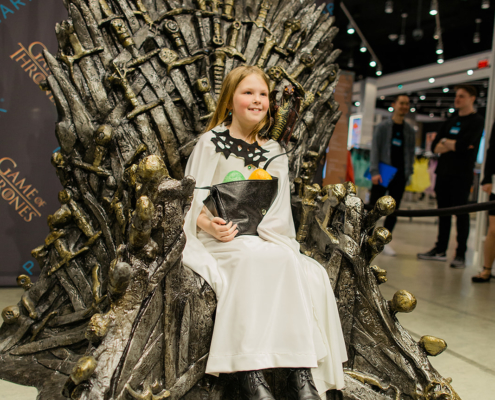 Fans in Game of Thrones costumes pose with the Iron Throne at Primark