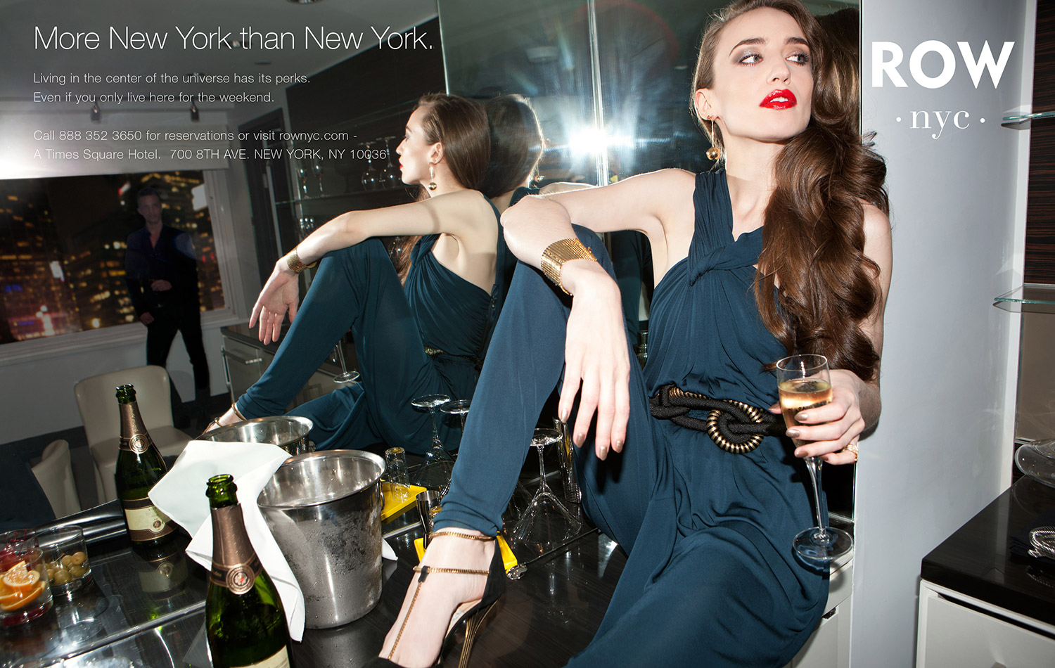 Model drinking champagne in kitchen for Row NYC ad