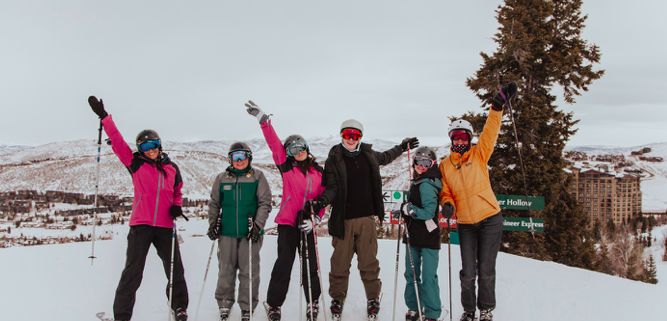 Group standing on the ski mountain at CBC Deer Valley Experience