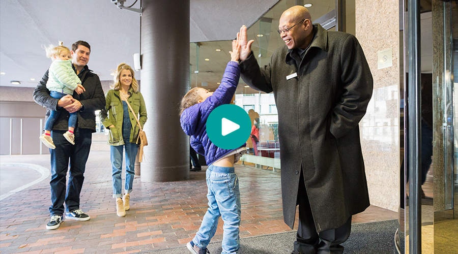 Family greeting doorman at Westin Sidebar Production