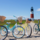 Four colorful bikes outside of a lighthouse at Parenting Experience