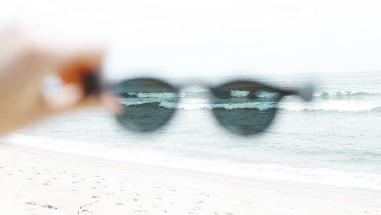 View of the ocean through sunglasses