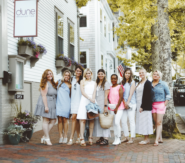 Women wearing Vineyard Vines outfits standing outside Nantucket restaurant