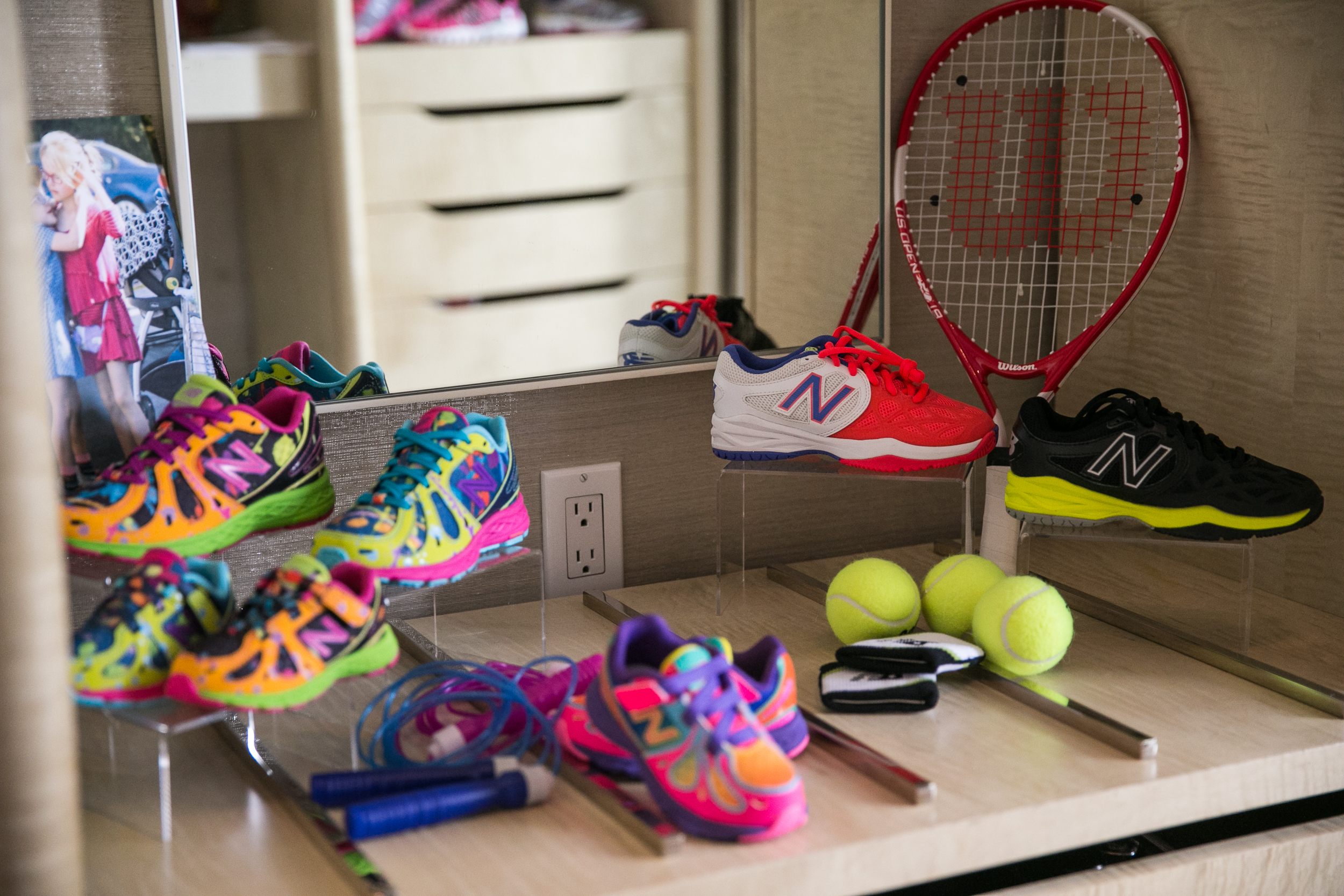 different angle of children's sneakers and tennis racket at cbc parenting house
