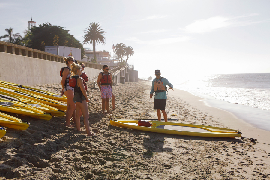 influencers and press learning to paddle board