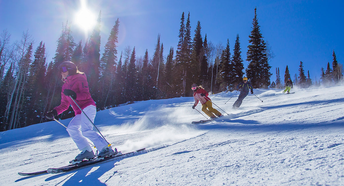 people skiing down mountain at CBC Deer Valley